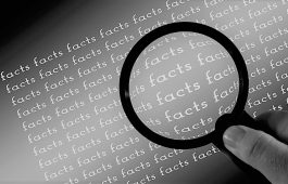 image shows a magnifying glass to illustrate a blog about VoIP myths